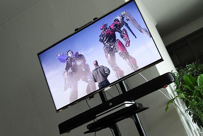 The soundbar is the same width as the TV.
