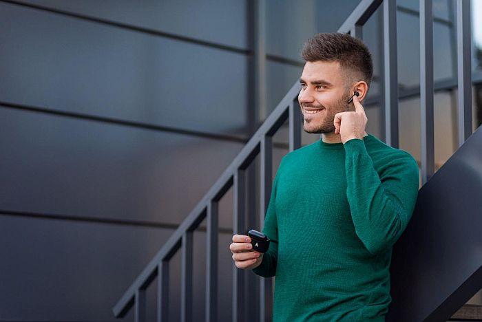 A man using xfyro headphones to take a phone call